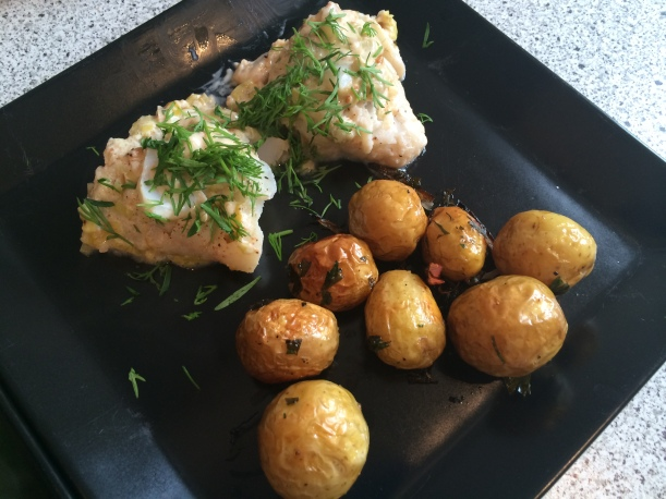 Broiled whitefish with remoulade and dill, alongside roasted new potatoes.