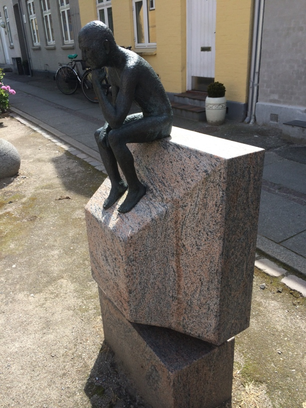 My interpretation of this statue? The thinking man is now deriving his ideas from the media. what do YOU think?